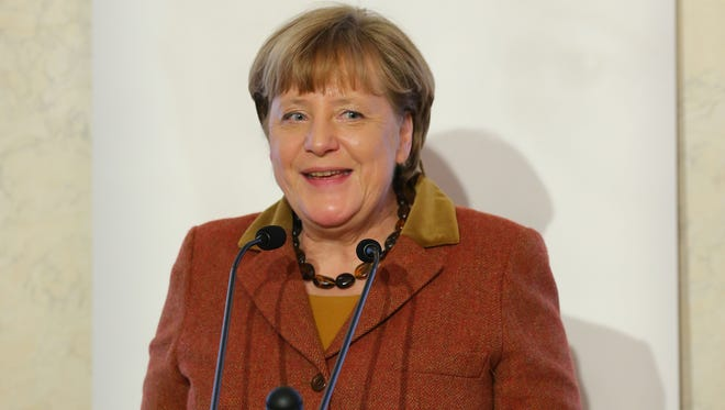 German Chancellor Angela Merkel talks after she receives the Eugen Bolz Award in recognition of her refugees policy from Stephan Neher, Chairman of the Eugen Bolz foundation on Feb. 1, 2017 in Stuttgart, Germany.