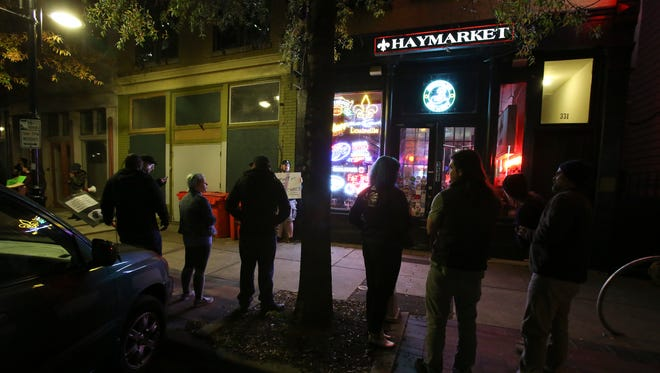 Haymarket Whiskey Bar in downtown Louisville closed briefly after its owner, Matthew Landan, was accused in a Facebook post of raping a woman. A group of activists protested outside the closed bar days after.