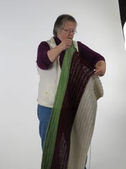 Beverly Dingman shows a blanket she plans to complete