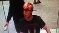 A surveillance photo from state police shows one of two men who used a stolen debit card to make a purchase Saturday at the Westchester Mall in White Plains. The debit card was stolen earlier Saturday during a burglary at a Somers pizzeria.