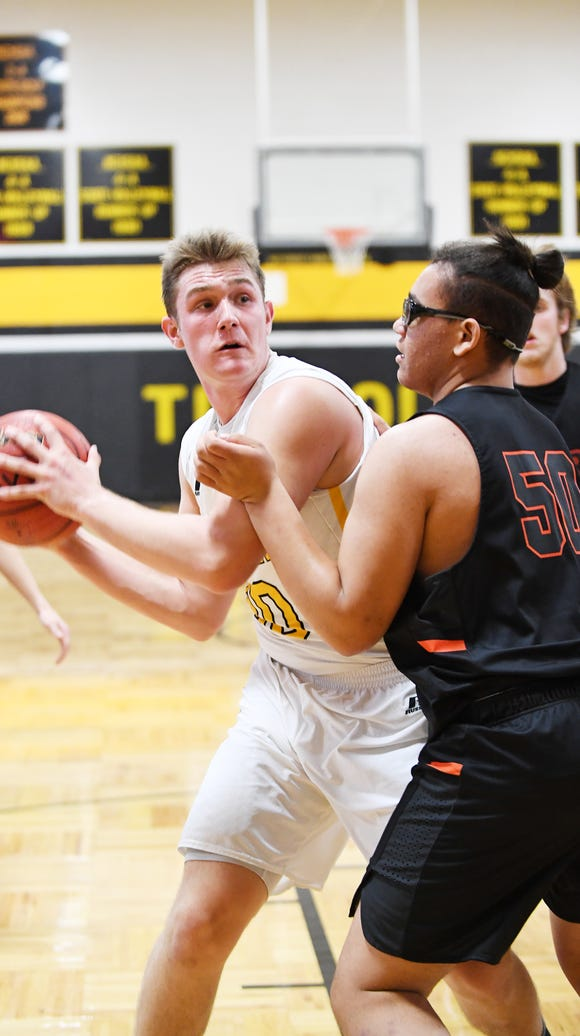 Tuscola's Landon Henley set a school-record for rebounds in Tuesday's win over Erwin.