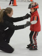 Learn to Skate instructor Alison Freier helps newcomer