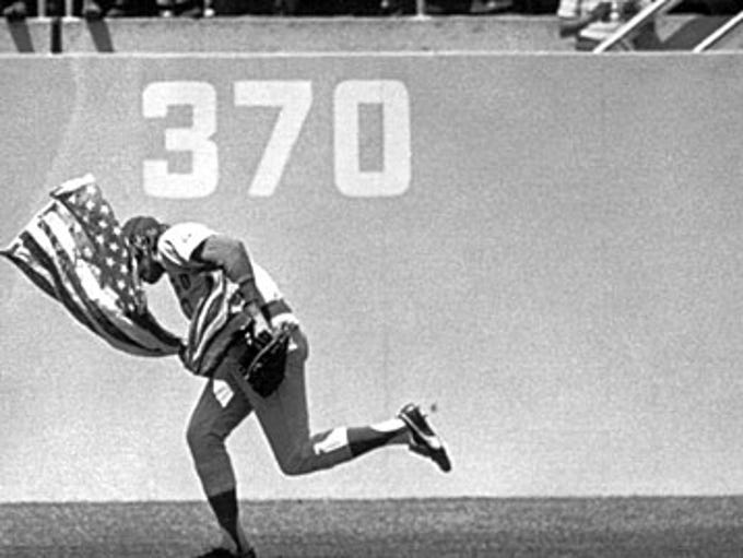 Outfielder Rick Monday of the Chicago Cubs dashes between