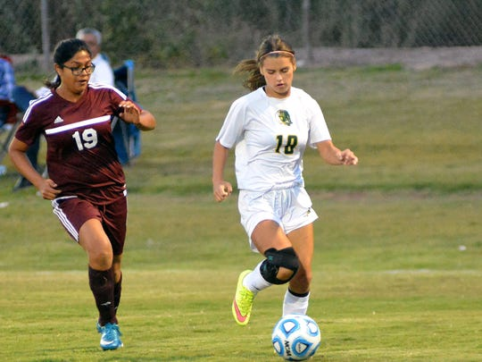 Mayfield's Michaela Bradley gets around Gadsden's Leslie Calderon during first half action at the Field of Dreams on Tuesday night.