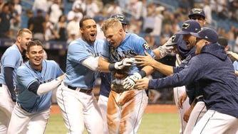 Tampa Bay Rays first baseman Jake Bauers (9) is congratulated by teammates at home plate.