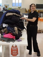 Courtney Raible, a member of The Arc Rockland's self advocacy organization, is pictured with more than 100 coats collected at The Arc and donated to TOUCH, an organization providing compassionate services to people with chronic illnesses.