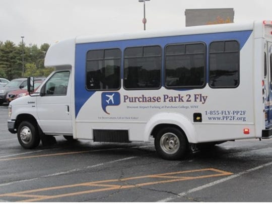A shuttle bus leaves Purchase College for the Westchester County Airport on Wednesday, Oct. 1, 2014. The college has earned hundreds of thousands of dollars by offering valet parking and a shuttle ride to the nearby airport. (AP Photo/Jim Fitzgerald)