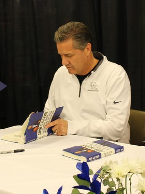 "University of Kentucky basketball coach John Calipari met with fans and signed his book ""Success is the Only Option"" at the Florence Marketplace on Mall Road on Nov. 30."