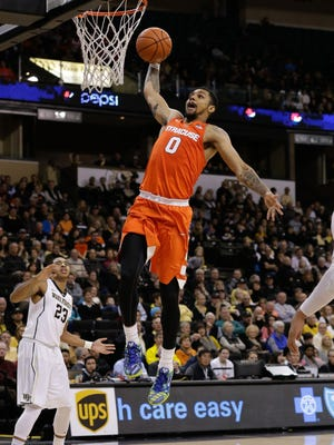 Syracuse Orange forward Michael Gbinije (0) goes up for a dunk in Syracuse's 83-55 win against Wake Forest on Jan. 16, 2016.