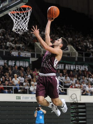 John Glenn's Drew Rackley scores on a layup during the Muskies' 70-50 Division II regional finals win over Columbus DeSales on Saturday in Athens. Rackley finished the game with 31 points.
