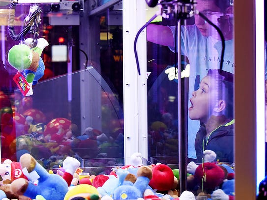 Ryan Conlon, 9, from Wyckoff, reacts as his friend wins a Luigi plush from the claw machine at the new arcade games at the Bowlero bowling alley in Fair Lawn.