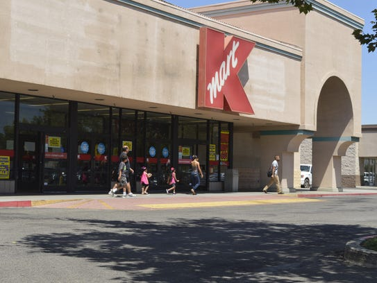 Shopper leave Kmart store in Tulare.