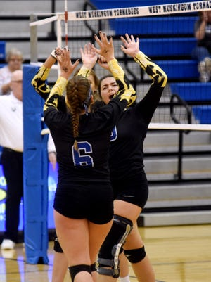 West Muskingum's Morgan Hopkins celebrates after a kill against Ridgewood during their Division III sectional tournament game at Gary Ankrum Gymnasium.
