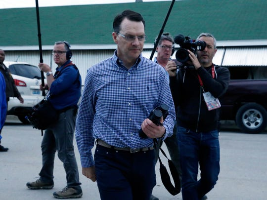 Kentucky Derby race horse Mendelssohn's trainer Aidan O'Brien walks to see his horse before the 144th running of the Kentucky Oaks horse race at Churchill Downs Friday, May 4, 2018, in Louisville, Ky. (AP Photo/Kiichiro Sato)