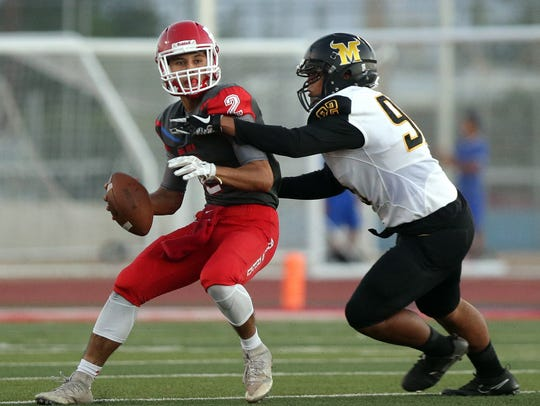 Bel Air quarterback Isaac Ybarra is sacked by Parkland