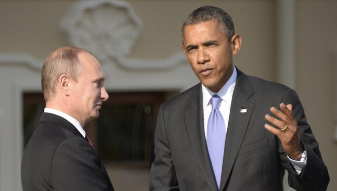 Russian President Vladimir Putin, left, welcomes President Obama at the start of the G-20 summit on Sept. 5, 2013, in St. Petersburg.