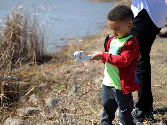 Jude Wilson focuses on catching a fish during Kid Fish