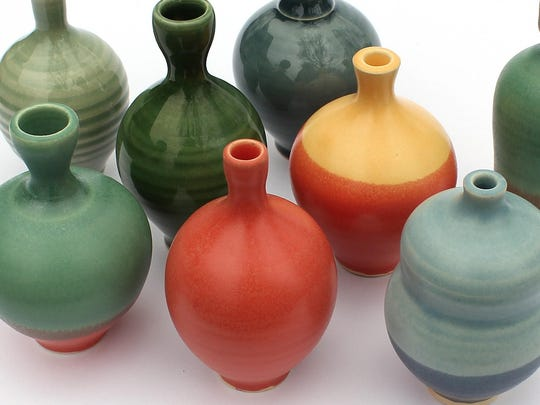 Pottery like these bud vases from Sara and Tom Gelsanliter will be on sale at the annual Potters Market in Southfield this weekend.
