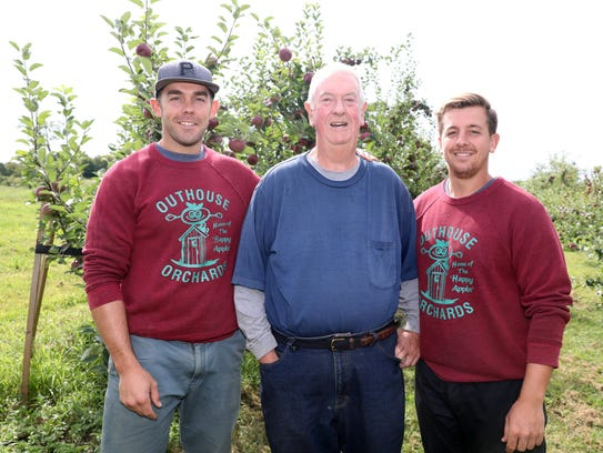 Owner Wayne Outhouse, center, and his sons, Andrew,