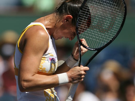 Flavia Pennetta of Italy celebrates after defeating Agnieszka Radwanska of Poland on Sunday, March 16, 2014 in the women's final at the BNP Paribas Open at the Indian Wells Tennis Garden in Indian Wells, Calif. Pennetta won in straight sets, 6-2, 6-1.