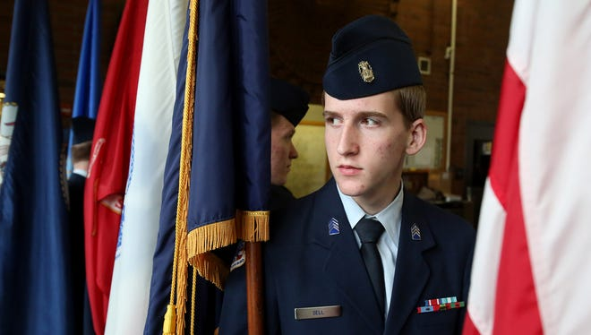 Jonathan Sell, with the McNary High School JROTC program, waits to  post the colors during a Veterans Recognition Luncheon hosted by the Keizer Chamber of Commerce on Tuesday, Nov. 10, 2015, in Keizer, Ore.