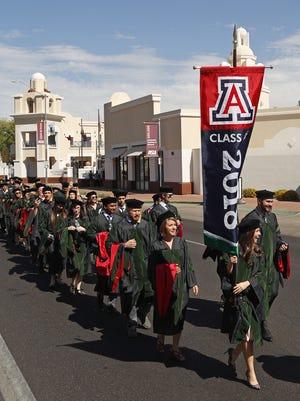 Arizona's Tiana Blank smiles as she leads the students to their University of Arizona College of Medicine's Phoenix Graduation Ceremony at Phoenix, Ariz. on May 7, 2018.