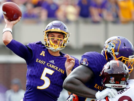 East Carolina's Gardner Minshew (5) releases a pass during the first half of an NCAA college football game against Virginia Tech in Greenville, N.C., Saturday, Sept. 16, 2017. (AP Photo/Karl B DeBlaker)