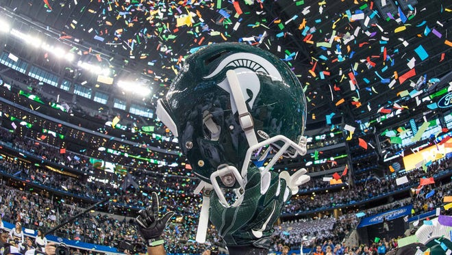 The Michigan State Spartans celebrate the win over the Baylor Bears in the 2015 Cotton Bowl Classic at AT&T Stadium.
