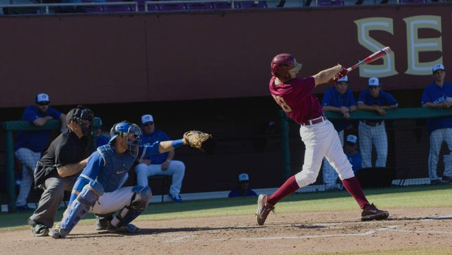 Dylan Busby (28) hits a homerun in the second inning. The Seminoles beat the Ontario Blue Jays 16-0.