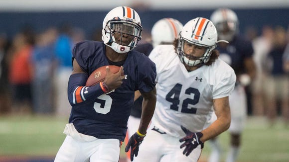 John Franklin III (5) says he's the fastest quarterback