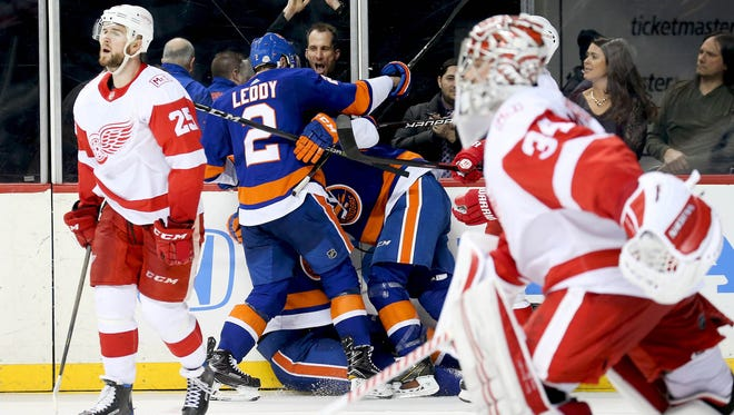 New York Islanders center Brock Nelson (29) is congratulated after scoring the game winning goal in overtime as Detroit Red Wings goaltender Petr Mrazek (34) and defenseman Mike Green (25) skate away at Barclays Center on Friday, Feb. 9, 2018.
