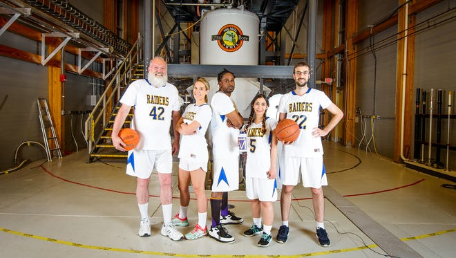 National MagLab Director Greg Boebinger, far left, and other MagLab staffers donned basketball uniforms from Rickards High School to prove the point that science is team sport. They are pictured here in front of one of the lab's world-record magnets, the 900 MHz MRI/NMR magnet.