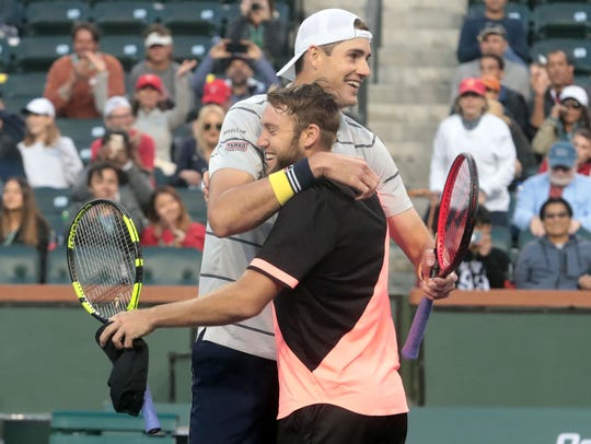 John Isner and Jack Sock, front, celebrate winning