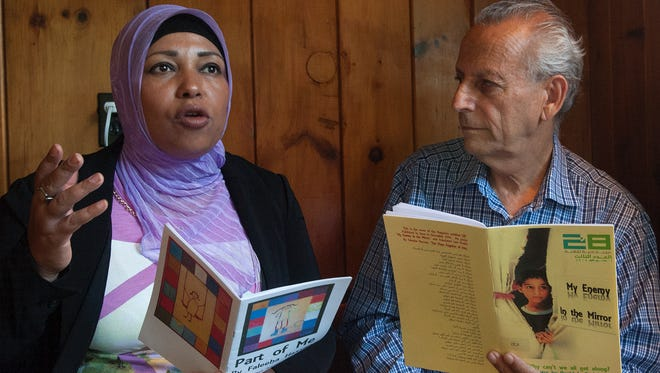 Poets  Faleeha Hassan and David Steinberg read poetry together throughout the region.
