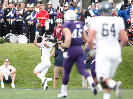 Wolf Pack wide receiver McLane Mannix catches a touchdown last week against Northwestern.
