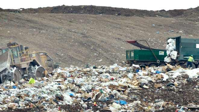 Truckloads of refuse are dropped and spread in the Orchard Ridge landfill. Waste Management has requested expansion of the facility.