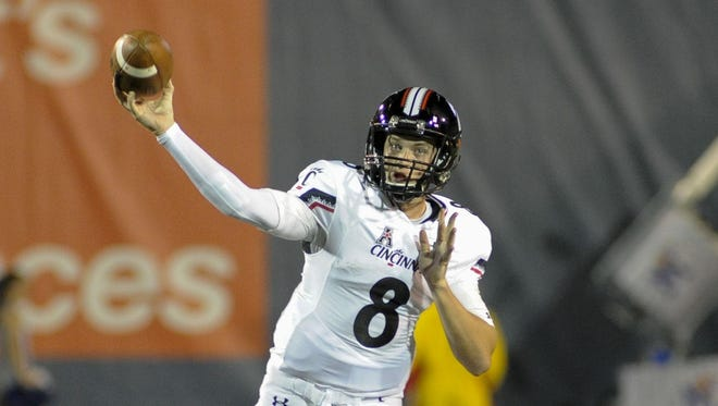 UC quarterback Hayden Moore came off the bench to throw for 557 yards against Memphis last Thursday.