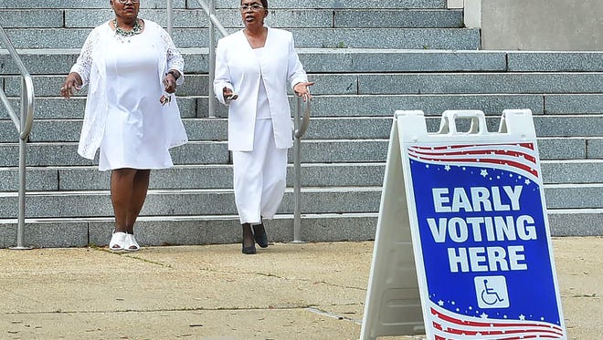 Parish residents exit the St Landry Parish Courthouse after casting their early vote Saturday.