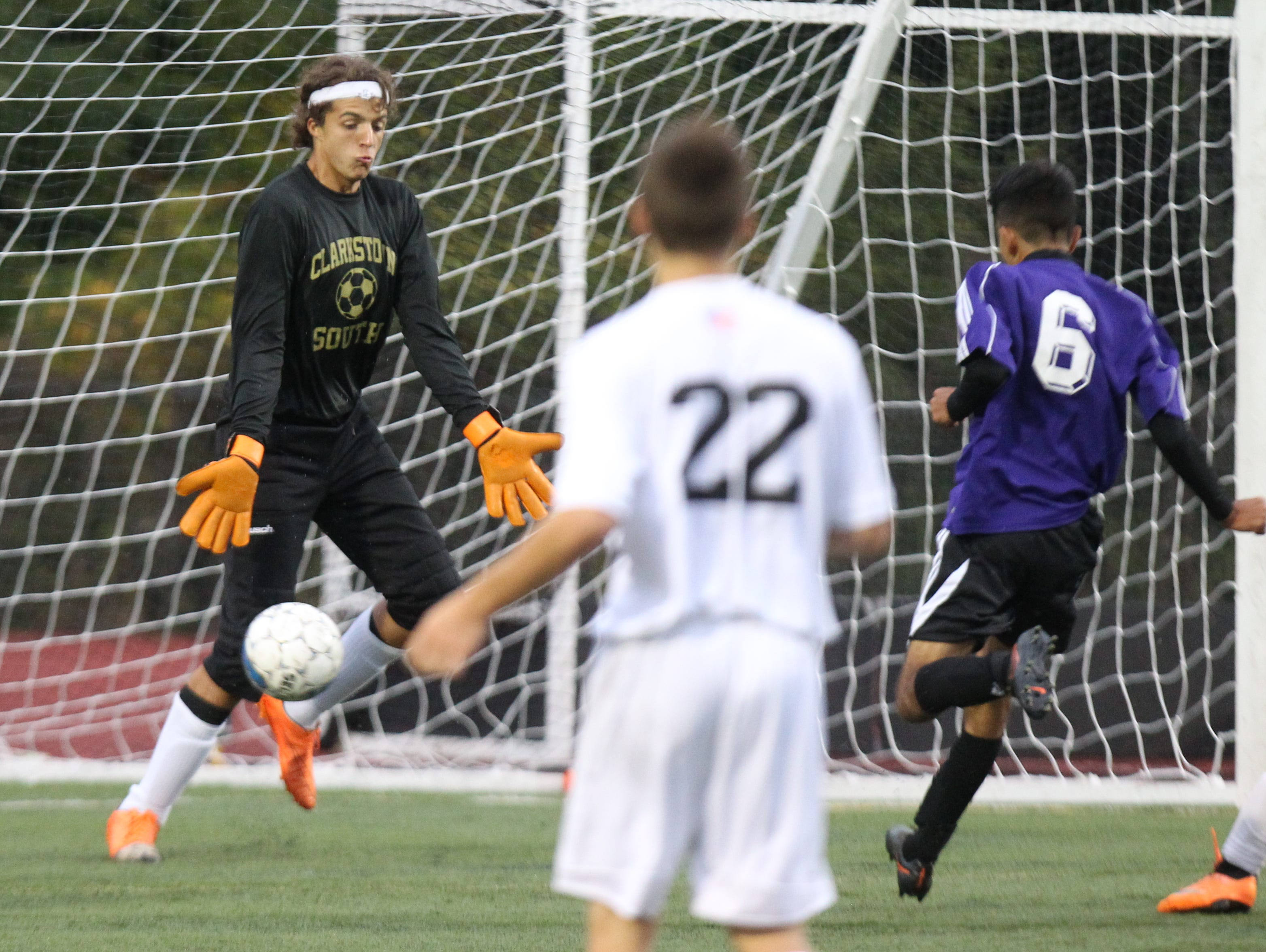 New Rochelle's Santiago Soto scores past Clarkstown South goalie Michael Tagaris during their game at Clarkstown South Sept. 30, 2015. New Rochelle won 3-1.