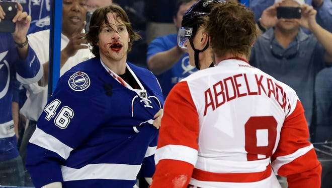 Lightning right wing Michael Blunden (46) is bloodied after a fight with Red Wings left wing Justin Abdelkader (8) during the third period of the Wings' Game 2 loss Friday in Tampa.