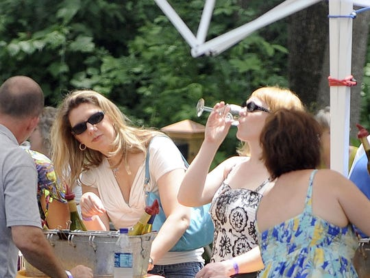 Tasters gather around the tent at Rockbridge Vineyard