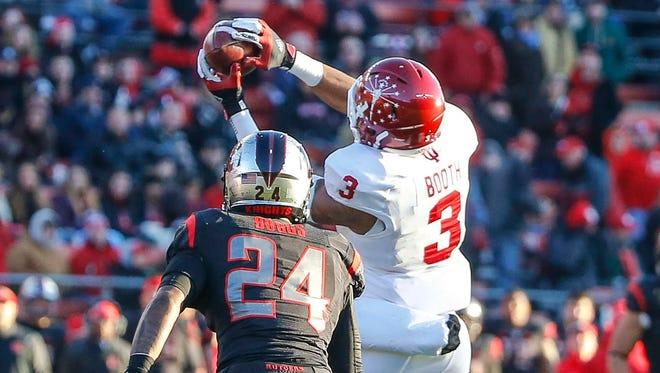 Indiana Hoosiers wide receiver Dominique Booth (3) catches pass infant of Rutgers Scarlet Knights defensive back Andre Boggs (24), Nov. 15, 2014.