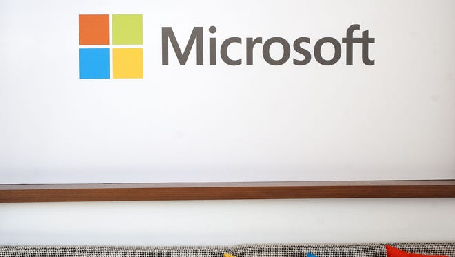 The Microsoft logo is seen before the start of a media event in San Francisco, California on Thursday, March 27, 2014.