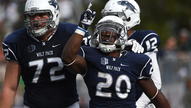 Nevada's James Butler (20) celebrates a touchdown while taking on Hawai'i during their football game at Mackay Stadium in Reno on Oct. 24 2015.