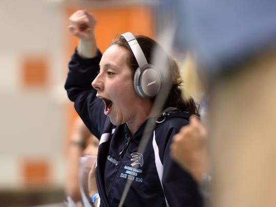 Erica Laning of Hardin Valley Academy cheers on a teammate during the Women's 100 butterfly Saturday at the Knox-area Interscholastic Swim League finals at University of Tennessee's Allan Jones Aquatic Center.