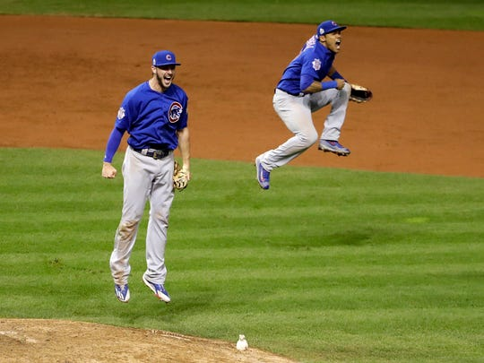 Chicago Cubs' Kris Bryant, left, and Addison Russell celebrate after Game 7 of the Major League Baseball World Series against the Cleveland Indians Thursday, Nov. 3, 2016, in Cleveland. The Cubs won 8-7 in 10 innings to win the series 4-3. (AP Photo/David J. Phillip)