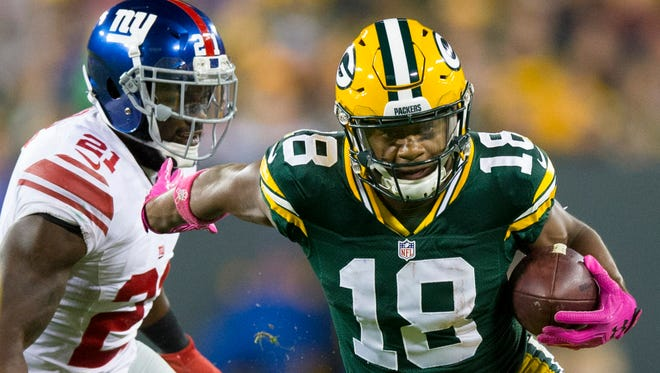 Green Bay Packers wide receiver Randall Cobb (right) tries to get past New York Giants safety Landon Collins during a game at Lambeau Field on Oct. 9.