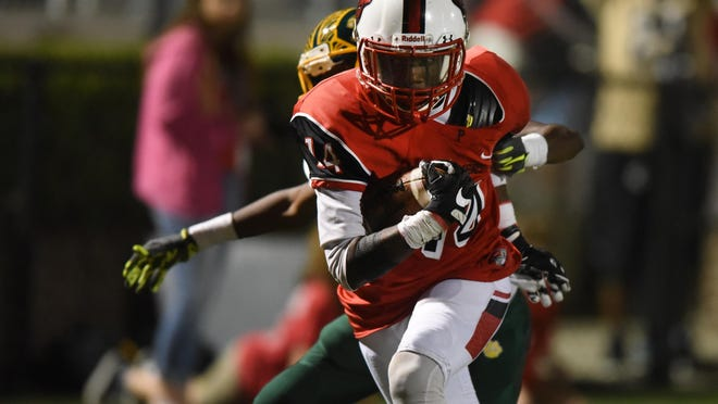 Petal High School wide receiver Nataurean Watts reaches for the end zone in a home game against Jim Hill on Friday.