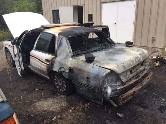 Shawnee's police cruiser was alledgedly torched by Christopher Venon Sr. on September 26 outside the village's sewage treatment plant. Vernon was indicted for the crime but his current whereabouts are unknown.