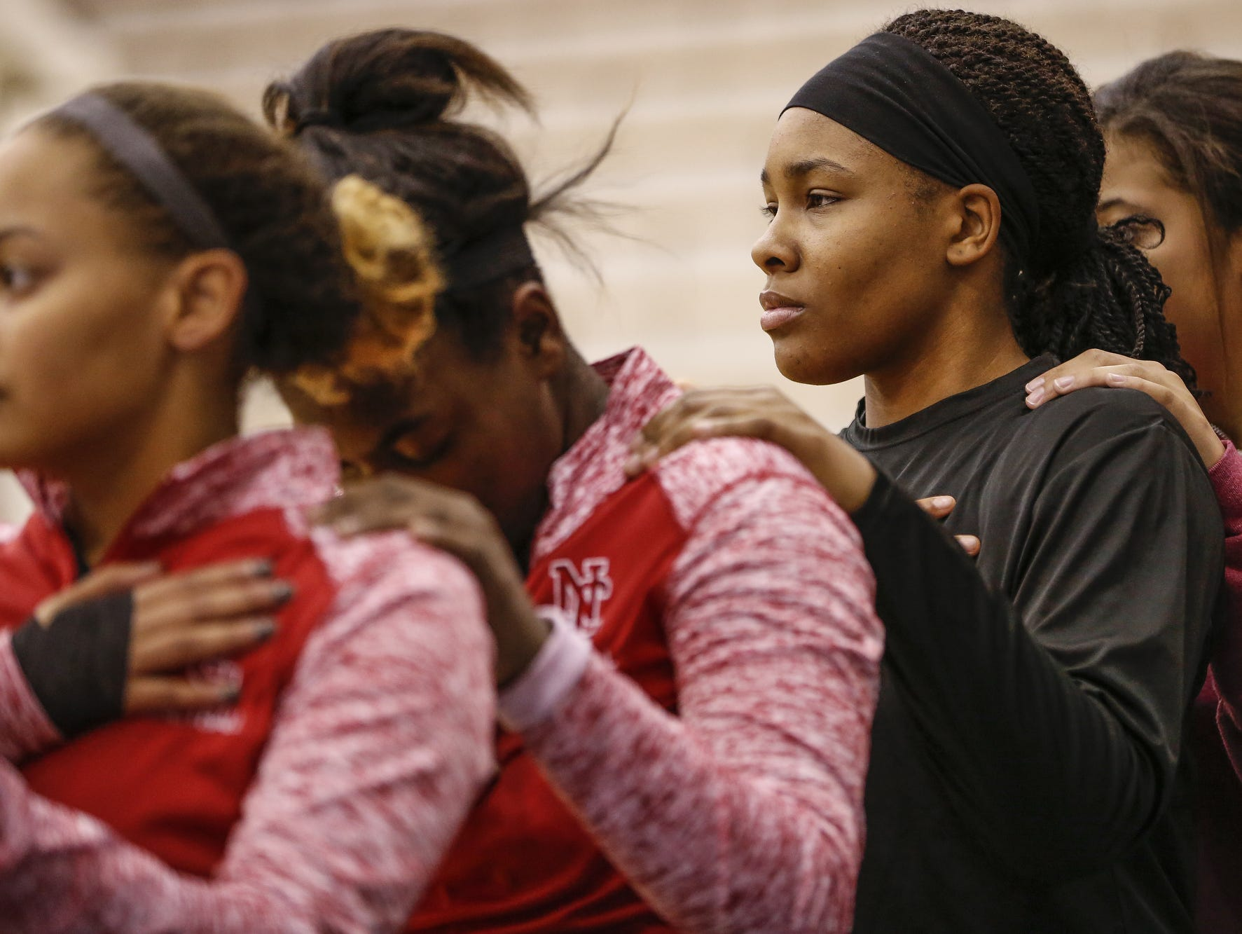 North Central Panthers' Ajanae Thomas, third from left, stood with teammates during the national anthem recently.